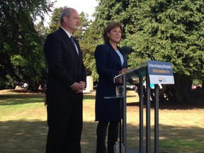 Premier Christy Clark and Finance Minister Mike de Jong announce a foreign buyers tax on Metro Vancouver real estate at the legislature in Victoria on July 25.