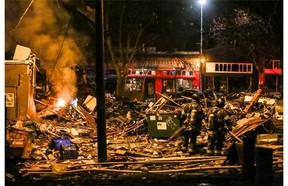 Firefighters work at the scene of a building explosion in Seattle's Greenwood neighborhood early Wednesday, March 9, 2016. (Genna Martin/seattlepi.com via AP) MAGS OUT; NO SALES; SEATTLE TIMES OUT; TV OUT; MANDATORY CREDIT