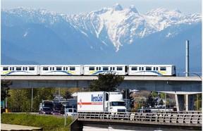 TransLink's SkyTrain zips over Hwy 1 as Hwy 1 crosses over Boundary Road. The distinction between the city of Vancouver and suburbs is so blurred that there is nothing here to indicate that Boundary is, well, the boundary between Vancouver and Burnaby.
