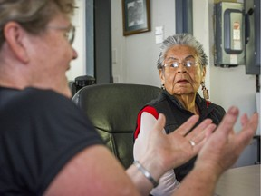 Elizabeth Phillips, the last fluent speaker of her Sto:lo people's language, listens as Simon Fraser University linguistics adjunct professor Susan Russell makes a point at the Cheam Band office in Chilliwack last week.