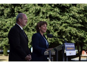 B.C. Finance Minister Mike de Jong and Premier Christy Clark announce the additional transfer tax of 15 per cent on foreigners purchasing homes in Metro Vancouver.