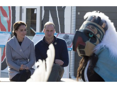 Prince William and his wife Kate, the Duke and Duchess of Cambridge, watch native youth dancers perform during a welcoming ceremony in Carcross, Yukon, Wednesday, Sept. 28, 2016.