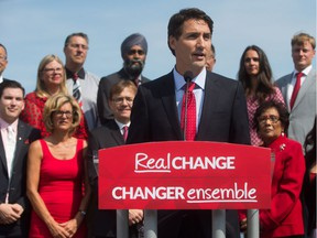 Justin Trudeau launches his party's election campaign in Vancouver last summer, with his West Coast candidates arrayed behind him. Three from the North Shore (front row, left to right) Terry Beech, Pamela Goldsmith-Jones and Jonathan Wilkinson would be most at risk in the event of a decision in favour of the Kinder-Morgan pipeline expansion.