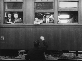 People of Japanese ancestry departing by train for an internment camp in B.C. in 1942.¤ Library and Archives Canada.