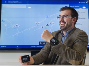 Gonzalo Tudela shows off the wearable devices used to help improve safety in productivity in mines.