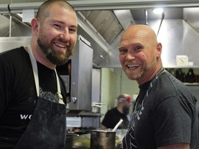 Chefs Nick Nutting of Tofino's Wolf in the Fog, left, and Todd Perrin from Newfoundland's Mallard Cottage cook up a harvest storm.
