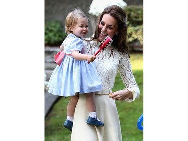Catherine, Duchess of Cambridge and Princess Charlotte of Cambridge at a children's party for Military families during the Royal Tour of Canada on September 29, 2016 in Carcross, Canada. Prince William, Duke of Cambridge, Catherine, Duchess of Cambridge, Prince George and Princess Charlotte are visiting Canada as part of an eight day visit to the country taking in areas such as Bella Bella, Whitehorse and Kelowna
