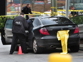 Delta Police and Surrey RCMP investigate a shooting at a car wash on Scott Road and 92nd Avenue in Delta on Monday. The victim was taken to hospital. Police are searching for suspects.