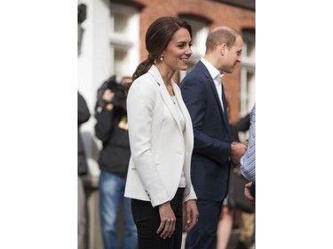 Kate, Duchess of Cambridge and Prince William, Duke of Cambridge speak with the official welcoming party upon arriving at the Cridge Family Centre in Victoria, BC, October, 1, 2016.