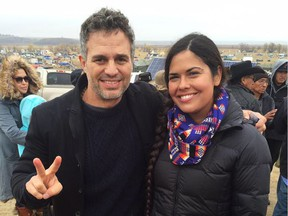 Tara Houska, indigenous lawyer and protest leader against the North Dakota Access Pipeline, poses for a photo with Hollywood actor and fellow anti-pipeline activist Mark Ruffalo after a rally in North Dakota in October.