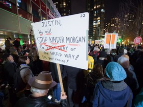 People listen during a protest against the Kinder Morgan Trans Mountain Pipeline expansion project, in Vancouver, B.C., on Tuesday November 29, 2016.