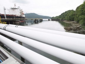 Kinder Morgan has increased the estimated cost of the Trans Mountain pipeline project to $7.4 billion and says it has confirmed shipping interest from producers. A ship receives its load of oil from the Kinder Morgan's Westridge loading dock in Burnaby, which will see increased tanker traffic as a result of the Trans Mountain pipeline expansion.