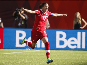 Canada's Christine Sinclair celebrates her game-winning, stoppage-time penalty-shot goal against China during FIFA Women's World Cup soccer action in Edmonton, Alta., in June 2015.