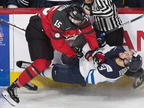 Canada's Jeremy Lauzon collides with Finland's Aaro Vidgren during second period pre-tournament exhibition hockey action in Montreal last Monday. Playing on home ice with a team built for speed and tenacity could be the right combination to put Canada in the gold medal hunt at the world junior hockey championship.