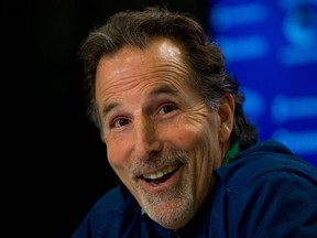 FILE - In this April 14, 2014, file photo, Vancouver Canucks' head coach John Tortorella laughs after a reporter mistakenly called him Mike during an end of season news conference in Vancouver, British Columbia. After an 0-7 start, the Blue jackets have fired coach Todd Richards and replaced him with John Tortorella, Wednesday, Oct. 21, 2015.(AP Photo/The Canadian Press, Darryl Dyck, File)