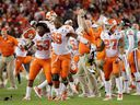 Clemson Tigers players celebrate on the sidelines after their quarterback Deshaun Watson threw the game-winning touchdown in the 35-31 upset win over No. 1-ranked Alabama in the U.S. College Football Playoff National Championship in Tampa, Fla., on Monday.