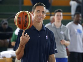 Former Los Angeles Laker Steve Nash spins a basketball at the start of a four-day training camp at a university in Havana in April 2015.