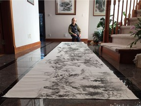 Taiwanese-Canadian artist John Chen with a portion of his 252-metre long watercolour.