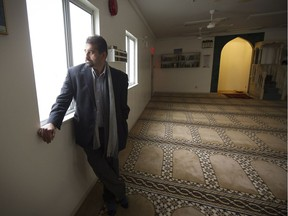 Haroon Khan reflects on a troubled weekend looks out from inside the Al Jamia mosque in Vancouver on Monday. 'I would say 99 per cent of Canadians are not hostile to Muslims,' he said.