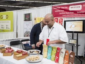 Chef Hamid Salimian, co-founder of NextJen Gluten-Free flour blends, arranges his products Sunday at the Specialty Food Expo in Vancouver.