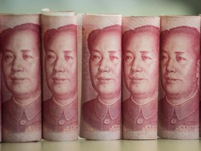 This photo illustration shows Chinese 100 yuan notes.