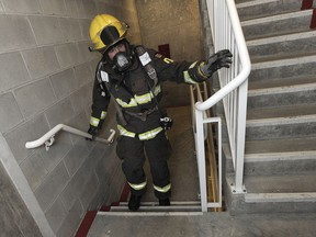 VANCOUVER, BC., February 23, 2017 -- Some of the 250 people including 100 BC firefighters climb ing 48 flights of stairs to the top of the Sheraton Wall Centre to raise awareness/funds for the BC Lung Association in Vancouver, BC., February 23, 2017. (NICK PROCAYLO/PostMedia)  00048065A ORG XMIT: 00048065A [PNG Merlin Archive]