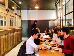 The tables at Jamjar on West 11th Avenue loop around the large kitchen, which is in the middle of the restaurant.