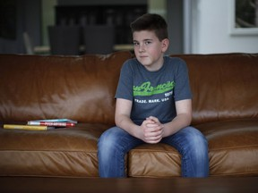 Alec Jones, 14, created an app for Facebook Messenger called Christopher Bot which helps with homework by sending reminders about when assignments are due. Jones poses for a photo at his home in Victoria, B.C., on Friday, March 10, 2017.