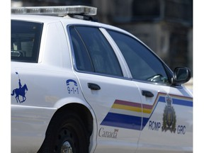 Police say a raid of a house in Surrey Friday turned up a trove of guns and drugs.