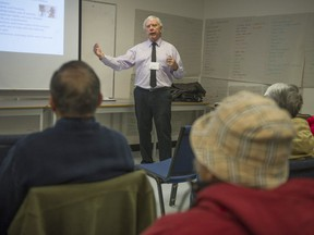 Retired educator Royce Shook holds a recent workshop at MOSAIC Immigrant Society in Burnaby. He provides advice about RRSPs and dealing with retirement.