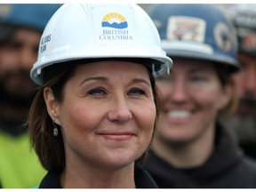 Premier Christy Clark looks on as ironworkers from Local 97 and the union representing more than 1,800 ironworkers in the province announce they are endorsing the Liberals during a press conference at a construction site along Johnston Street in Victoria, B.C., on Wednesday, March 1, 2017.