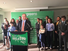 BC Green leader Andrew Weaver unveils his party's climate change platform while flanked by candidates and others in Victoria.