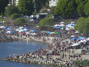 Thousands of people gathered at last year's 4/20 event at Sunset Beach.