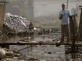 Mark Angelo stands on a small bridge in the heart of the extremely polluted Dhaka leather district in the Bangladesh capital.