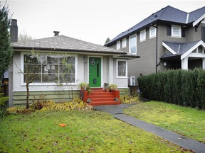 An older house sits next to a large modern house, a typical scene in Vancouver's Dunbar neighbourhood.
