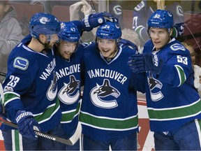 Alex Edler (left) might be the only Canucks veteran outplaying youthful players like (from left) Sven Baertschi, Reid Boucher and Bo Horvat.