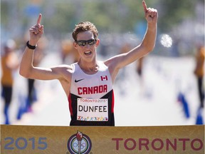 Evan Dunfee of Richmond crosses the finish to win gold in the men's 20-kilometre racewalk at the Pan Am Games in Toronto in 2015. He'll be competing in Sunday's 33rd annual Vancouver Sun Run. THE CANADIAN PRESS/AP