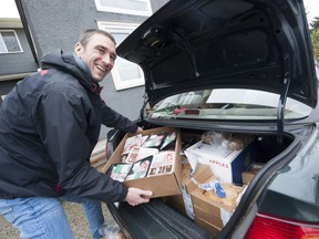 Volunteer Igor Bjelc unloads donated food at Aunt Leah's Place, a charity based in New Westminster that aids teen mothers and youths in foster care system, on Friday.