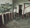Demetre Theodosakis cleans up during the refurbishment of Cosmos in 1999 after a flood in White Rock caused extensive damage.