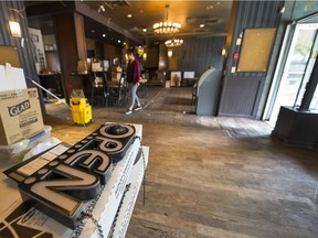 The OPEN sign at Vancouver's Dover Arms is turned off Tuesday. The neighbourhood institution closed-up shop after four decades in the West End because of the rising costs of doing business.