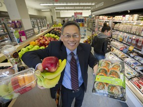 Chong Bang, Shoppers' senior vice-president of merchandising, shows off some of the fresh food items now available at the drugstore's East Hastings location.