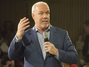 B.C. NDP Leader John Horgan leads a rally in Vancouver on April 11, 2017.