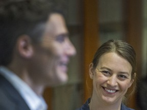 Newly appointed chief resilience officer Katie McPherson smiles as Mayor Gregor Robertson speaks during a news conference announcing her appointment in Vancouver on Tuesday.