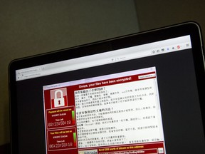 An investigation into a scourge of NetWalker ransomware attacks has led to the arrest of a Canadian man, the U.S. Department of Justice said on Wednesday. A screenshot of the warning screen from a purported ransomware attack is shown in a file photo.