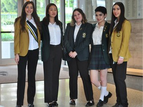 From left, Maggie Coval, Amanda Lim, Maren Gilbert Stewart, Ysabella Delgado and Kira Tosefsky show off school uniform at York House School in Vancouver, which includes options for trousers starting this fall.