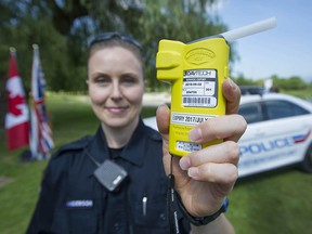 VPD constable Andrea Anderson holds a Alco-Sensor FST Approved Screening Device, also-known-as a breathalyzer, that will be deployed during a province-wide summer counter-attack enforcement program.
