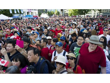 The crowd sings O Canada at the 2017 Canada Day celebrations at Canada Place in Vancouver