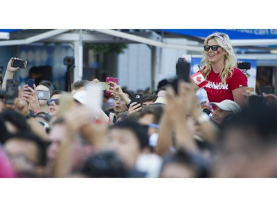 The crowd sings O Canada at the Canada Day celebrations at Canada Place, Vancouver, July 01 2017.