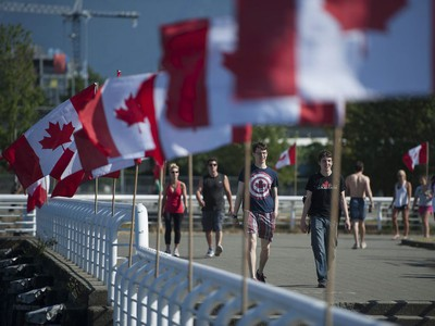 Vancouver, BC: July 01, 2017 -- People take advantage of the warm weather to storell along Creekside Park in Vancouver, BC Saturday, July 1, 2017.   (Photo by Jason Payne/ PNG) (For story by Glenda Luymes) ORG XMIT: canadadaydrumming [PNG Merlin Archive]  VANCOUVER OUT Jason Payne, PNG