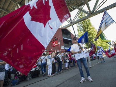 People take advantage of the warm weather to participate in Canada day festivities at Granville Island in Vancouver, BC Saturday, July 1, 2017.   (Photo by Jason Payne/ PNG)